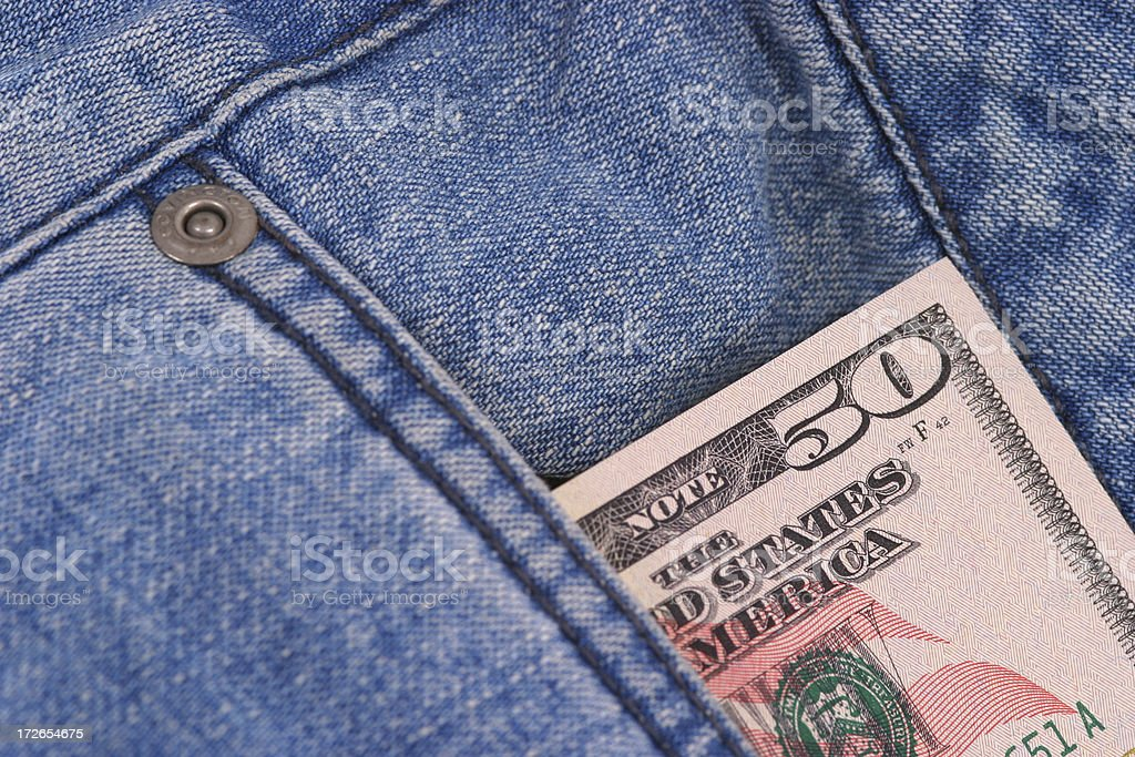 Fifty Dollars in pocket royalty-free stock photo