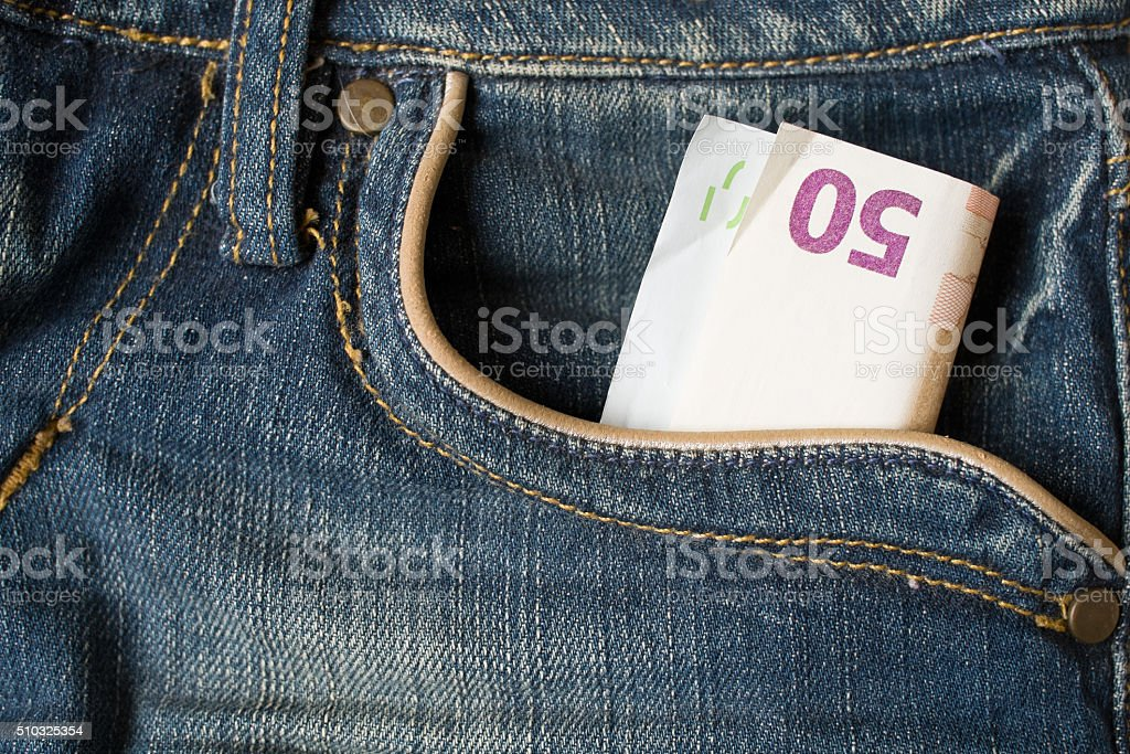 fifty euro in pocket stock photo