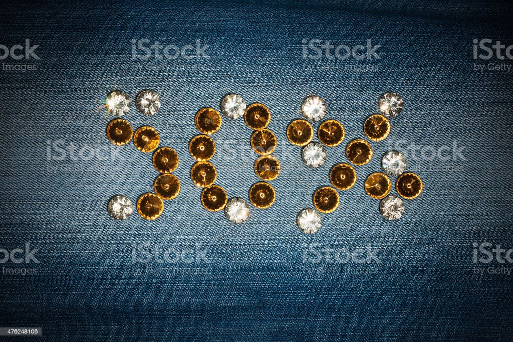 Fifty percent made from crystals on jeans fabric stock photo