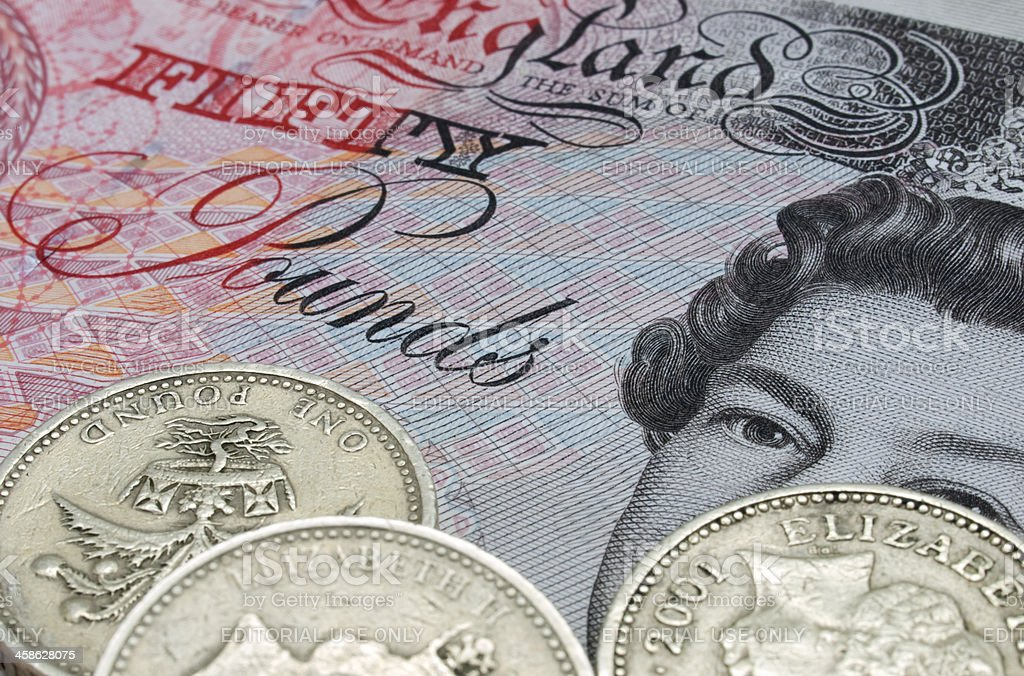 Fifty Pound note and coins royalty-free stock photo
