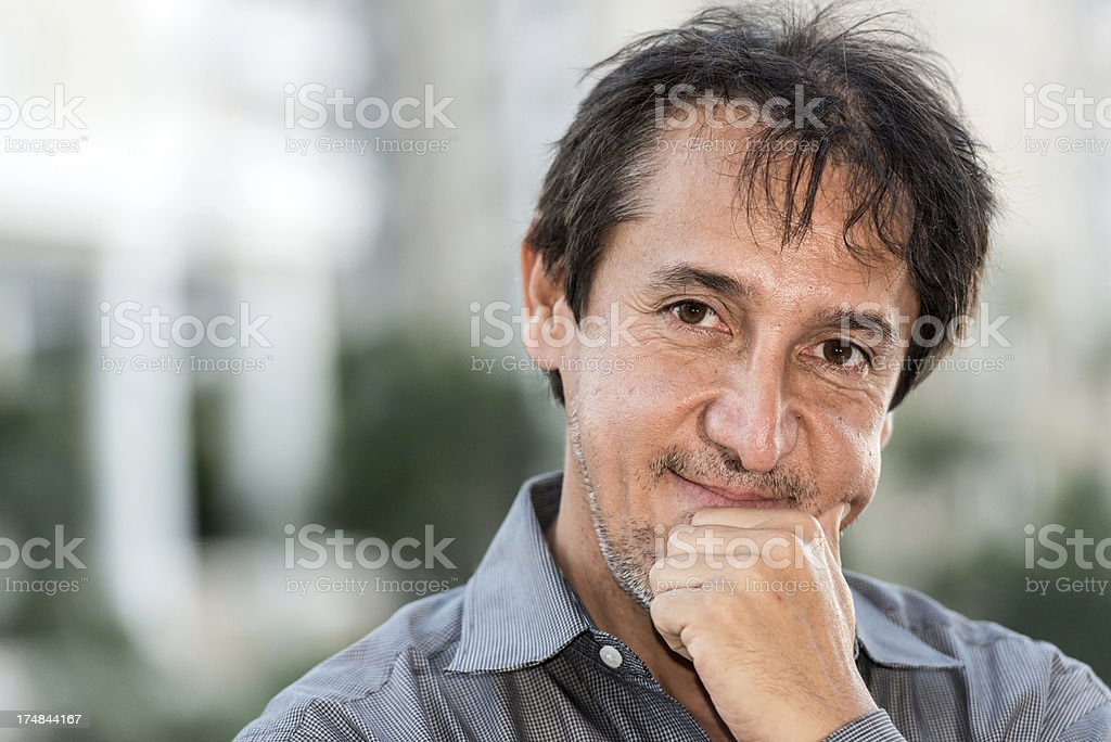 fifty something hispanic man royalty-free stock photo