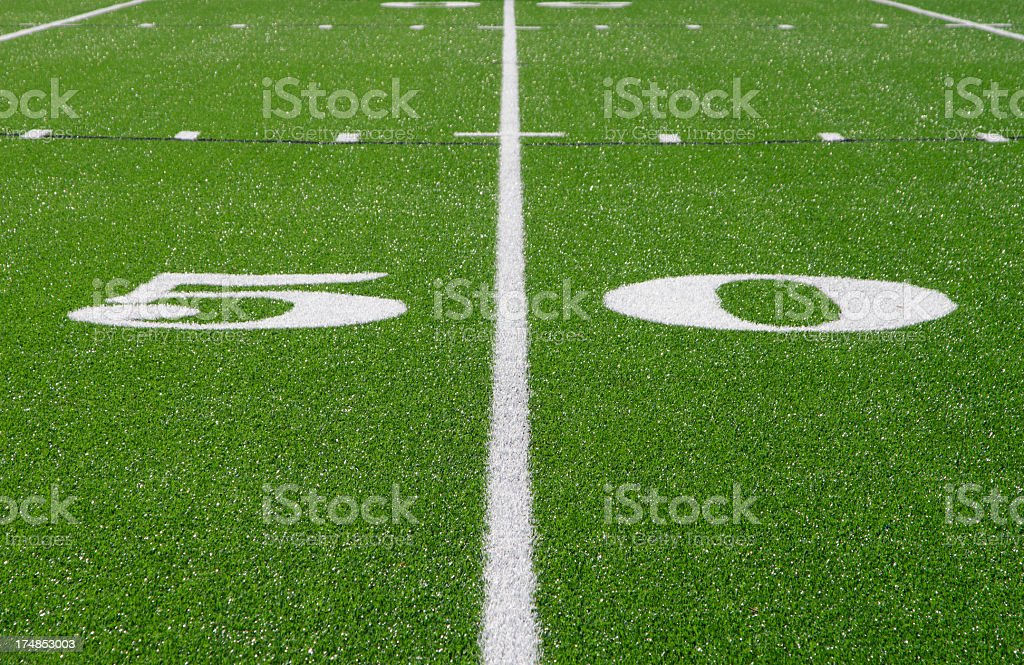 Fifty Yard Line painted white on football field royalty-free stock photo
