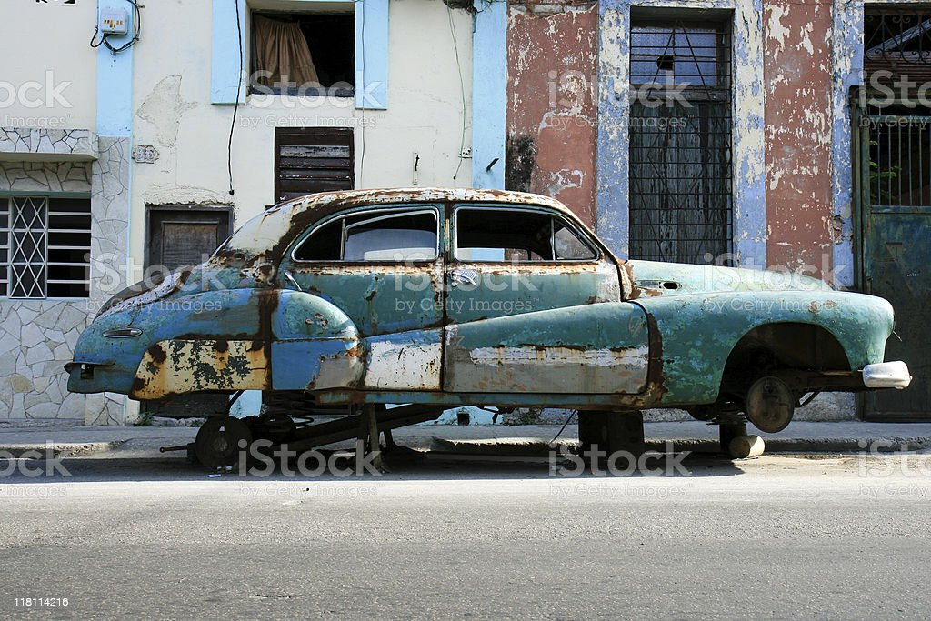 fifty years old car wrecks without wheels suspended cuba street stock photo