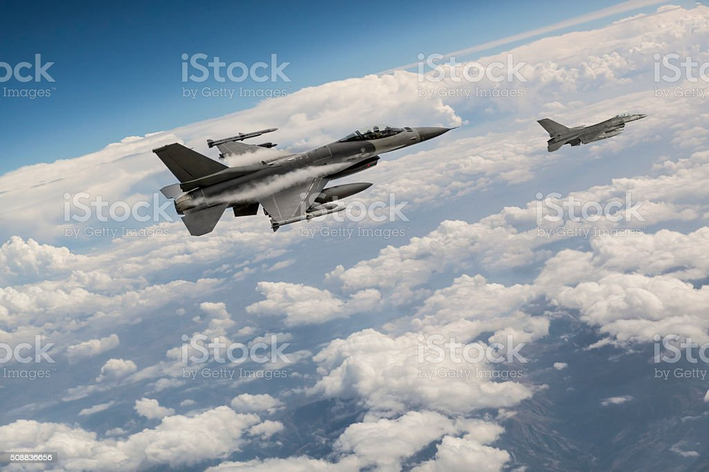 Figher jets above the clouds stock photo