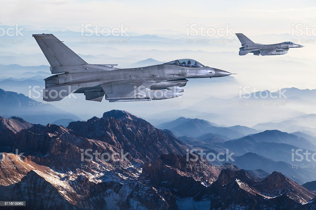Figher jets flying over the mountains stock photo