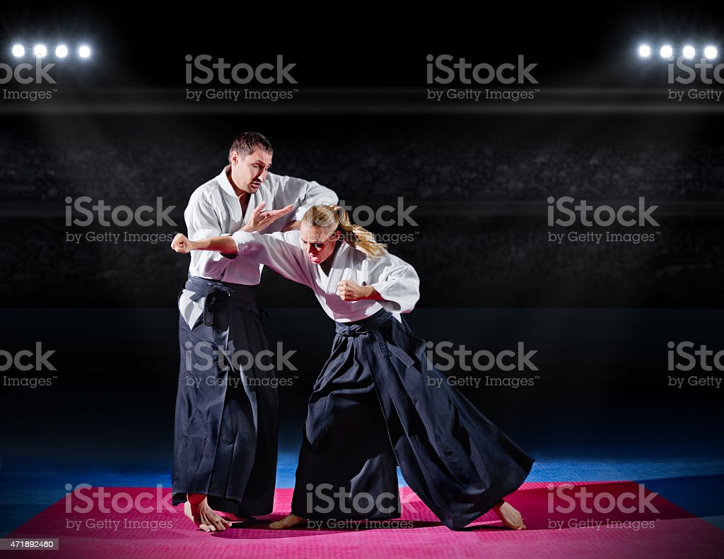 Fight between two aikido fighters stock photo
