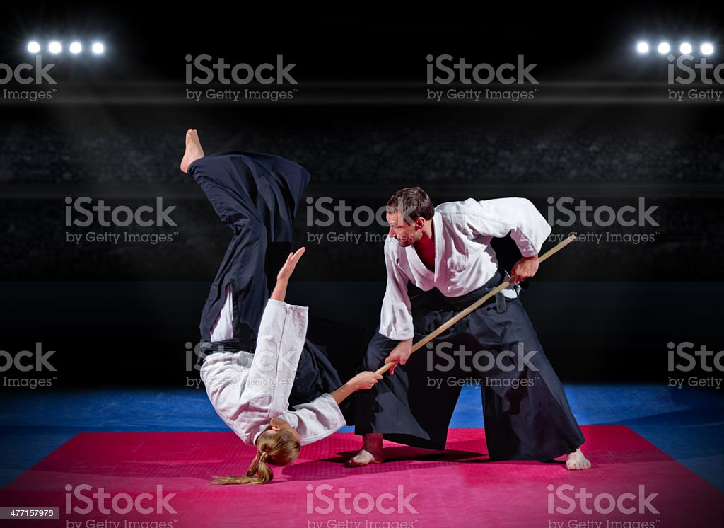 Fight between two martial arts fighters stock photo