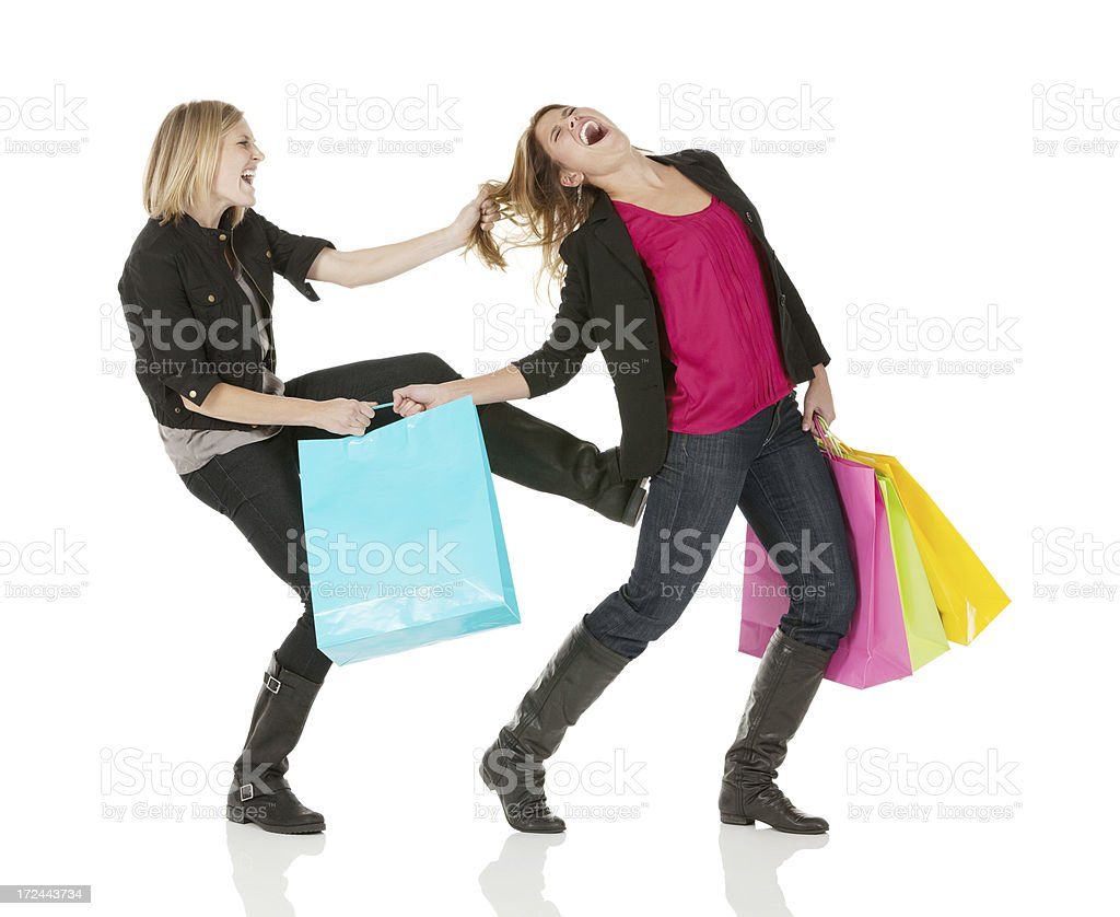 Fight for shopping bag stock photo