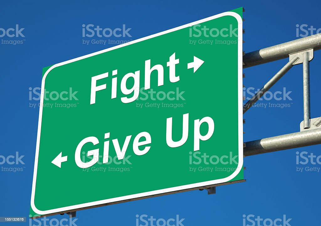 Fight or Give Up Highway Sign royalty-free stock photo