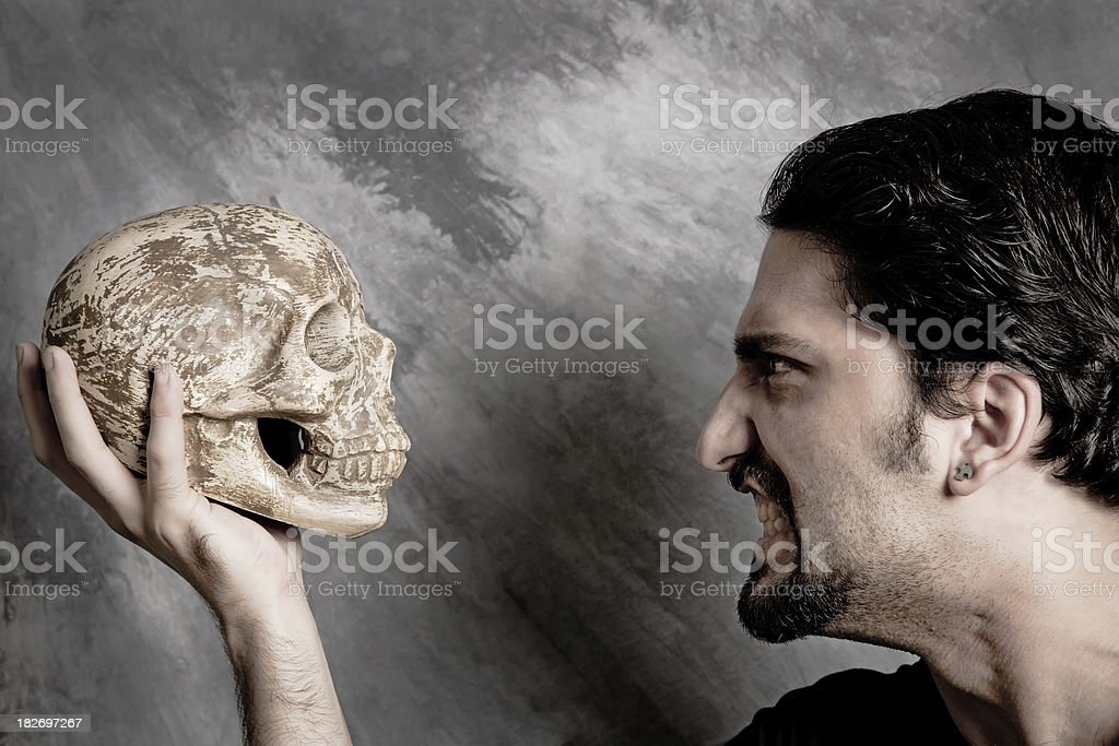fight with a skull royalty-free stock photo