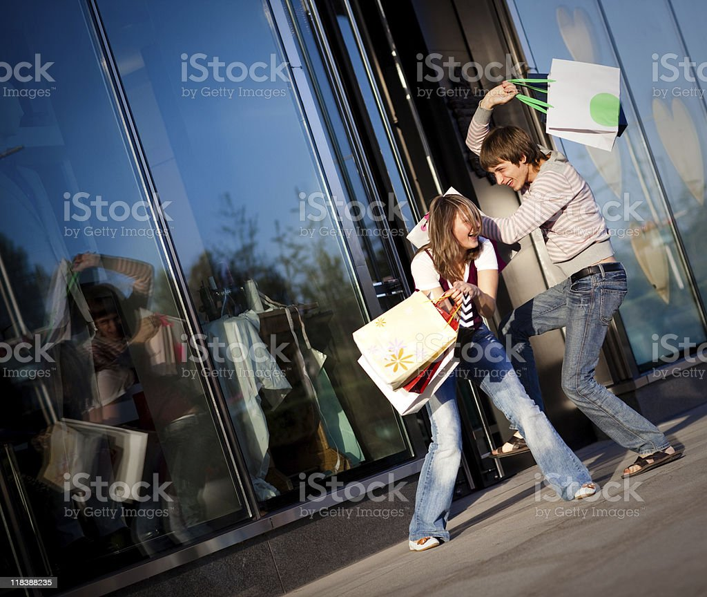 Fight with gift bags royalty-free stock photo