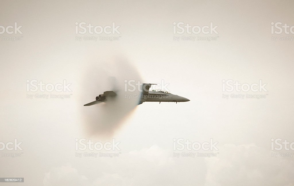 Fighter jet about to break the sound barrier stock photo