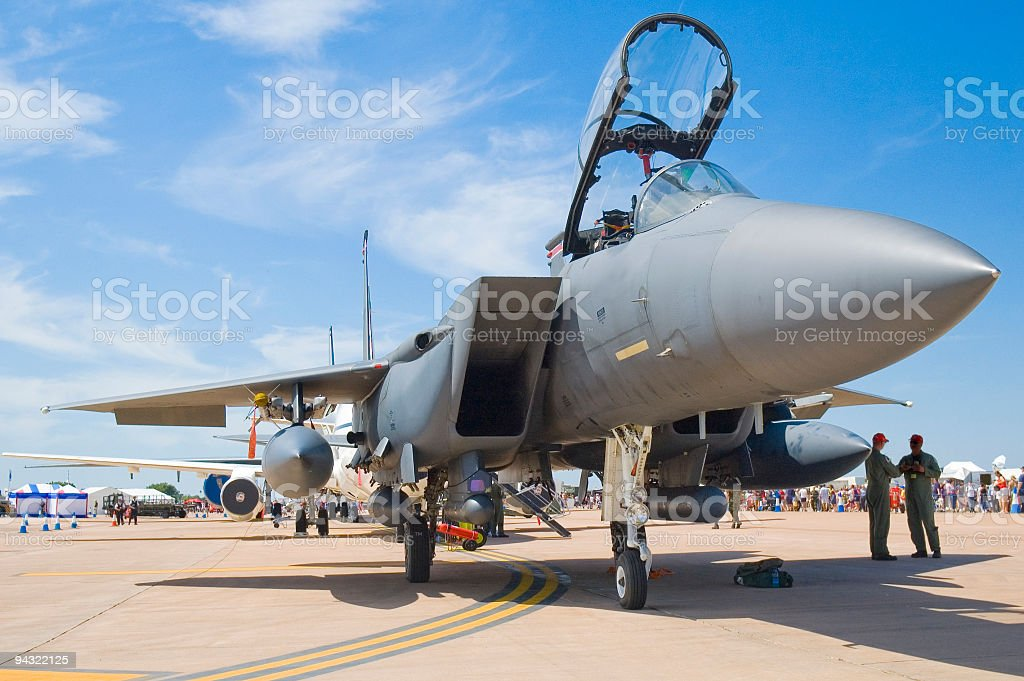 Fighter jet and crew stock photo