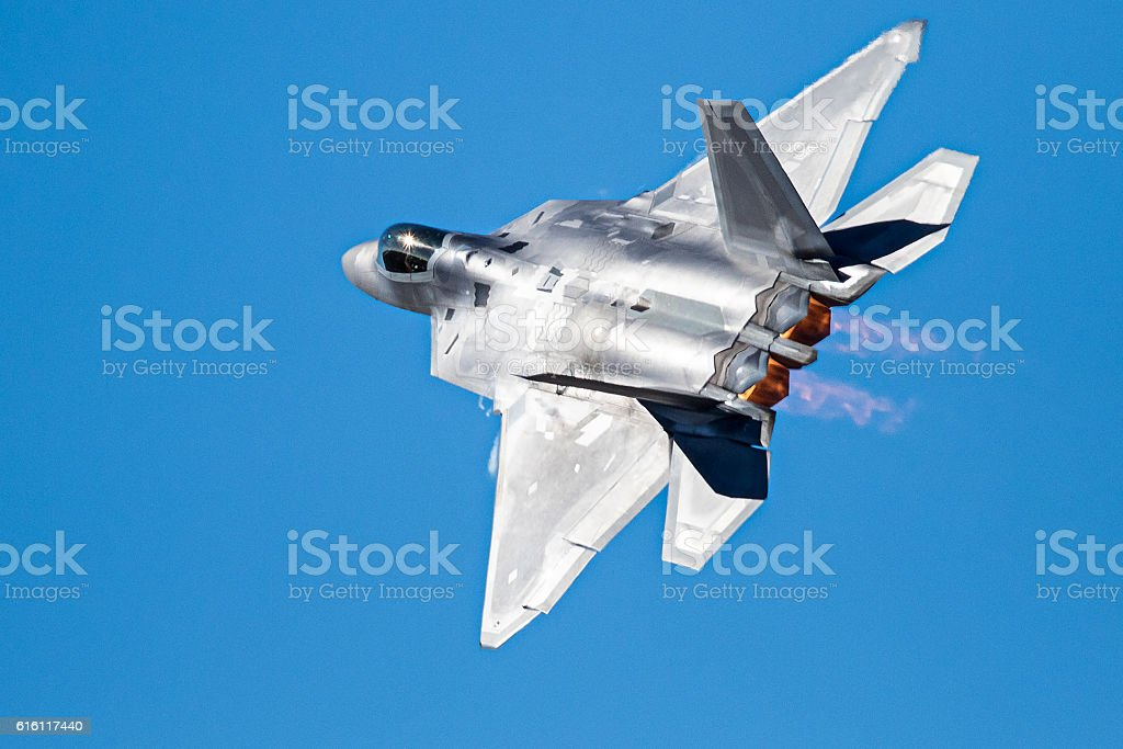 Fighter jet in a high g turn stock photo