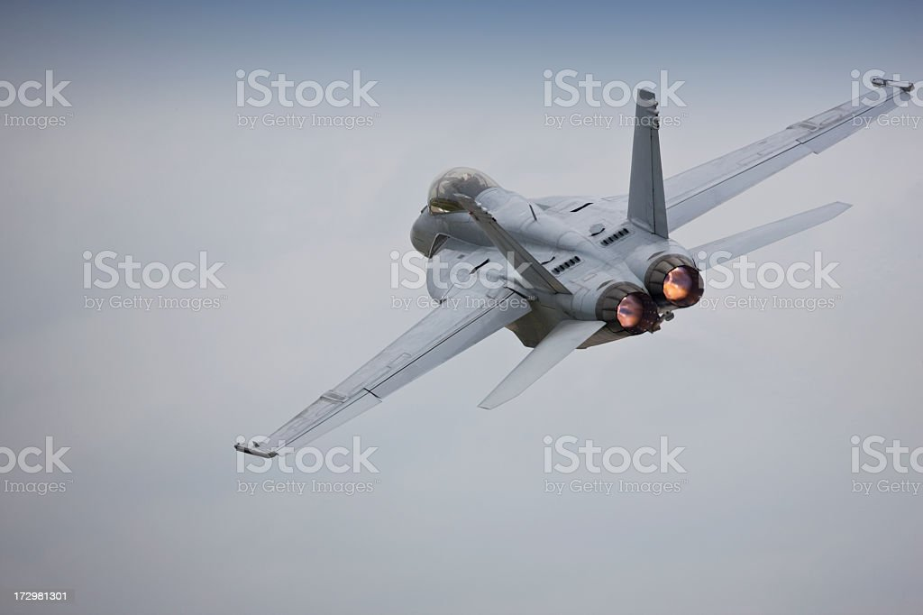 A fighter jet in flight using afterburners royalty-free stock photo