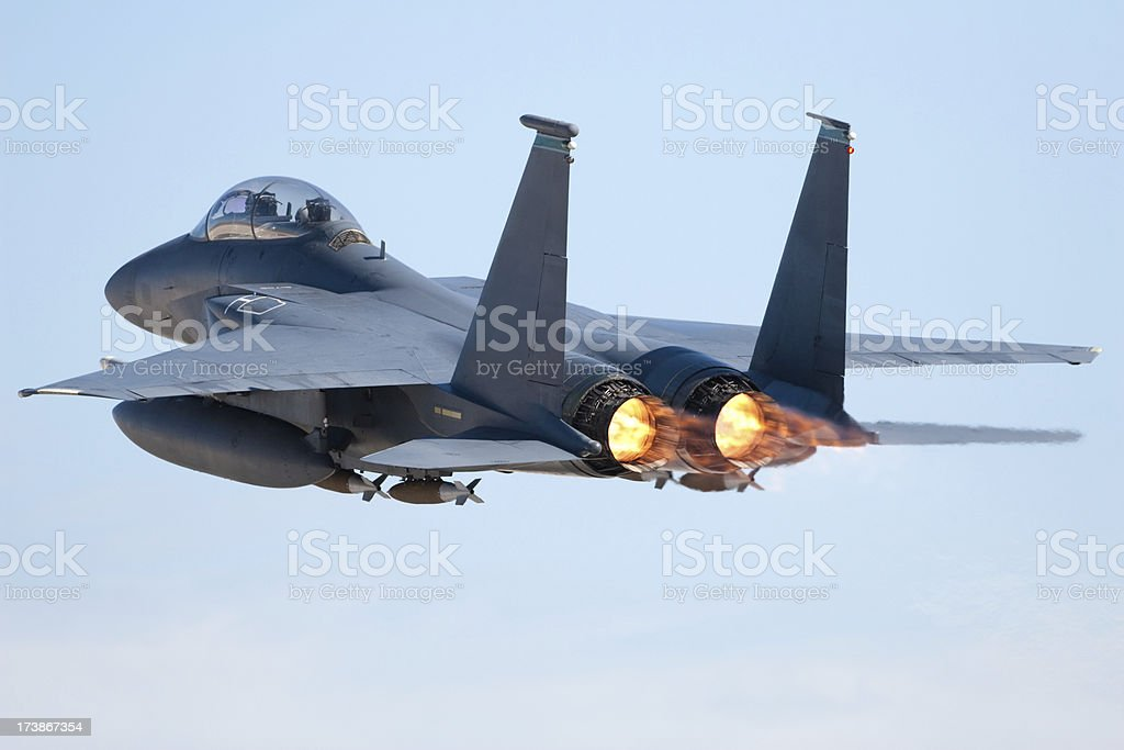 Fighter jet in flight with afterburners activated stock photo