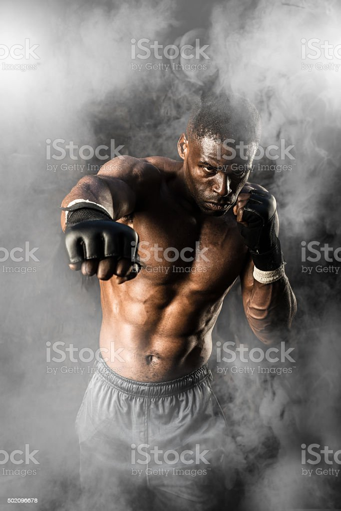 MMA Fighter On A Smokey  Background stock photo