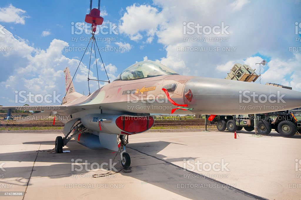 F-16 fighter on the crane at exhibition stock photo