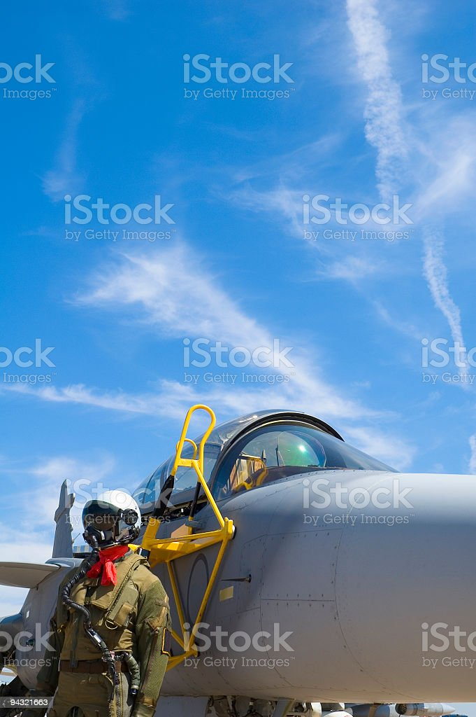 Fighter pilot and plane royalty-free stock photo