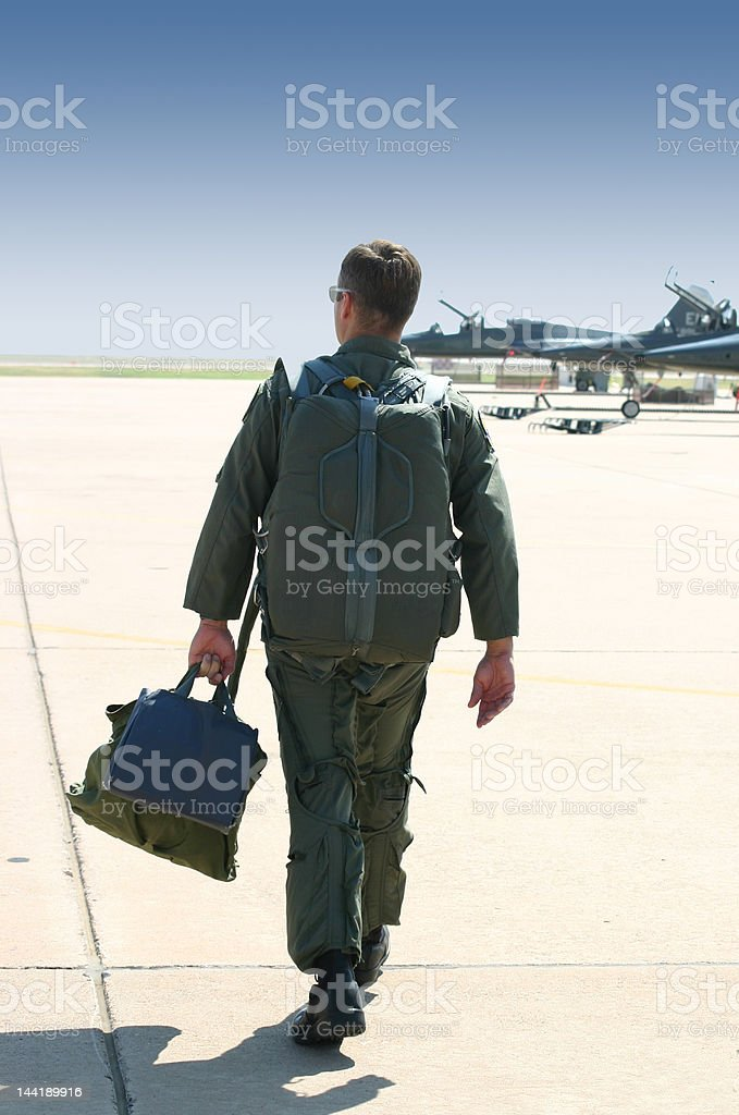 Fighter pilot walking to fly stock photo