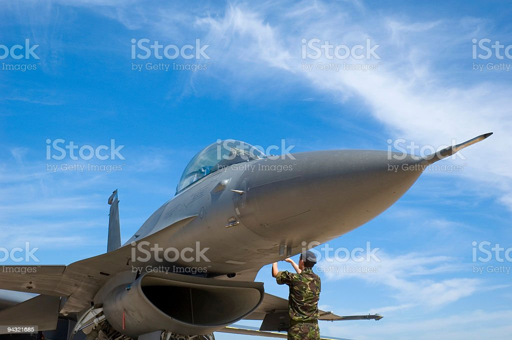 Fighter plane and technician stock photo