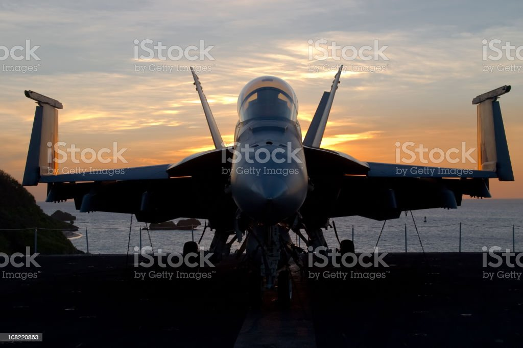 Fighter Plane at Sunset stock photo