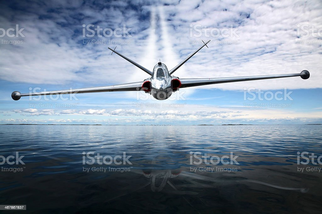 Fighter plane flying low over the water stock photo