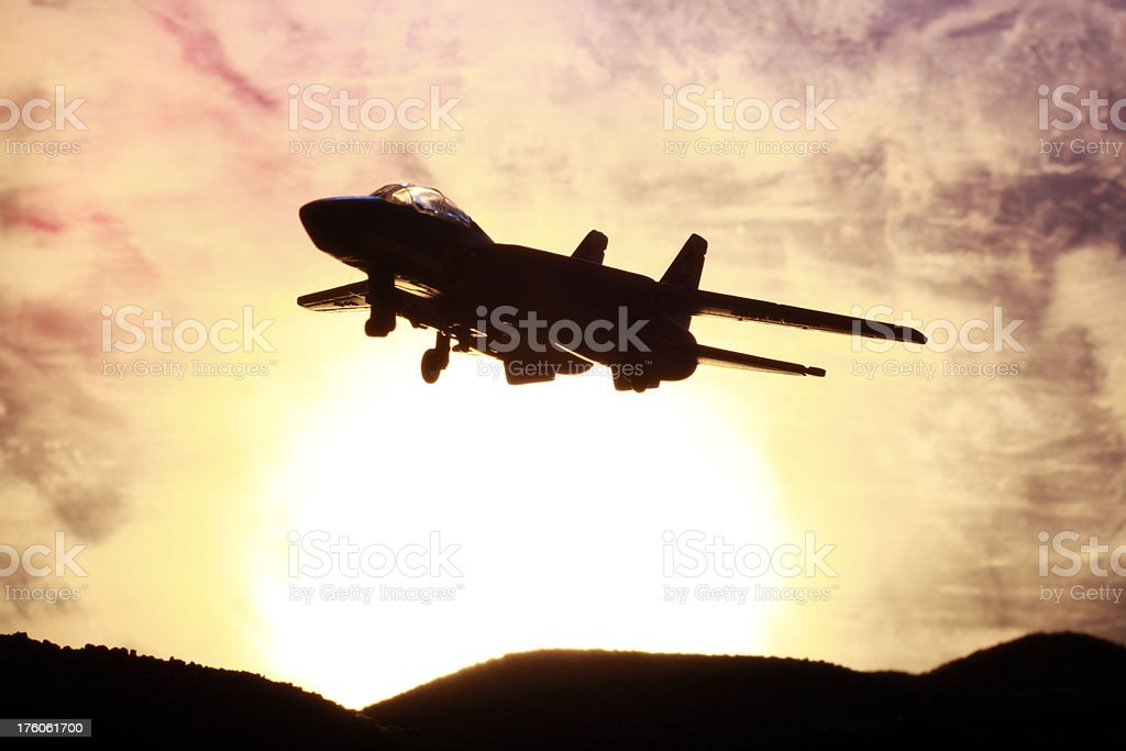 Fighter plane in the sunset royalty-free stock photo