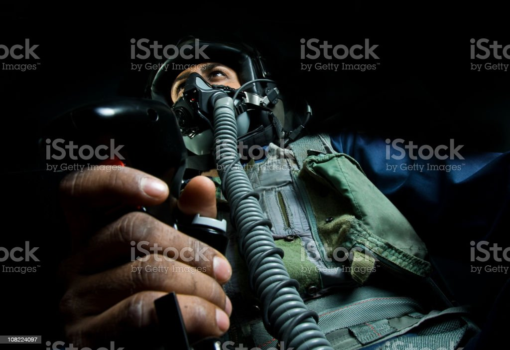 Fighter Plane Pilot Holding Throttle Wearing Helmet stock photo