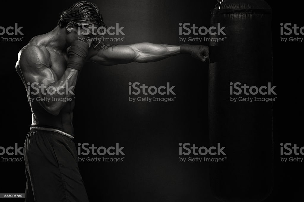 MMA Fighter Practicing With Boxing Bag stock photo