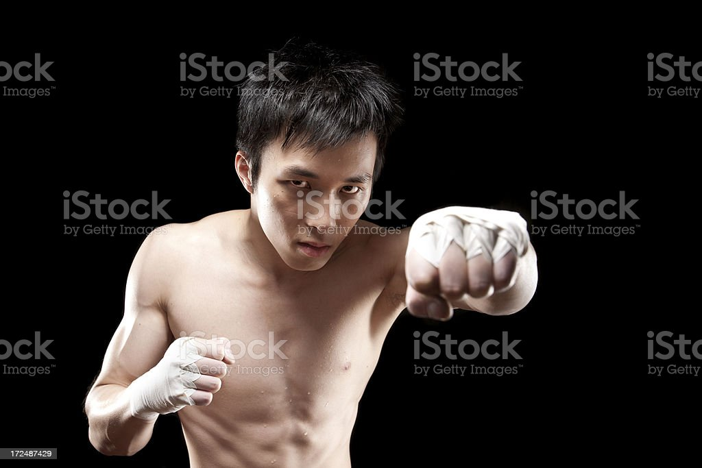 Fighter Punching towards camera stock photo