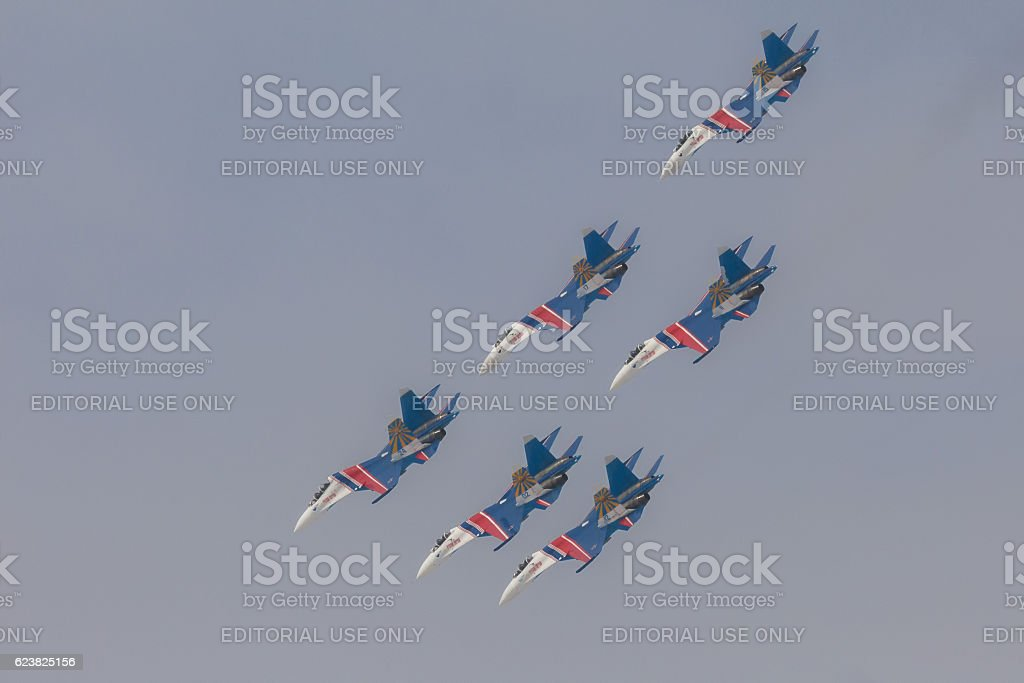 Fighter Sukhoi Su-27 show aerobatics at an airshow Russian stock photo