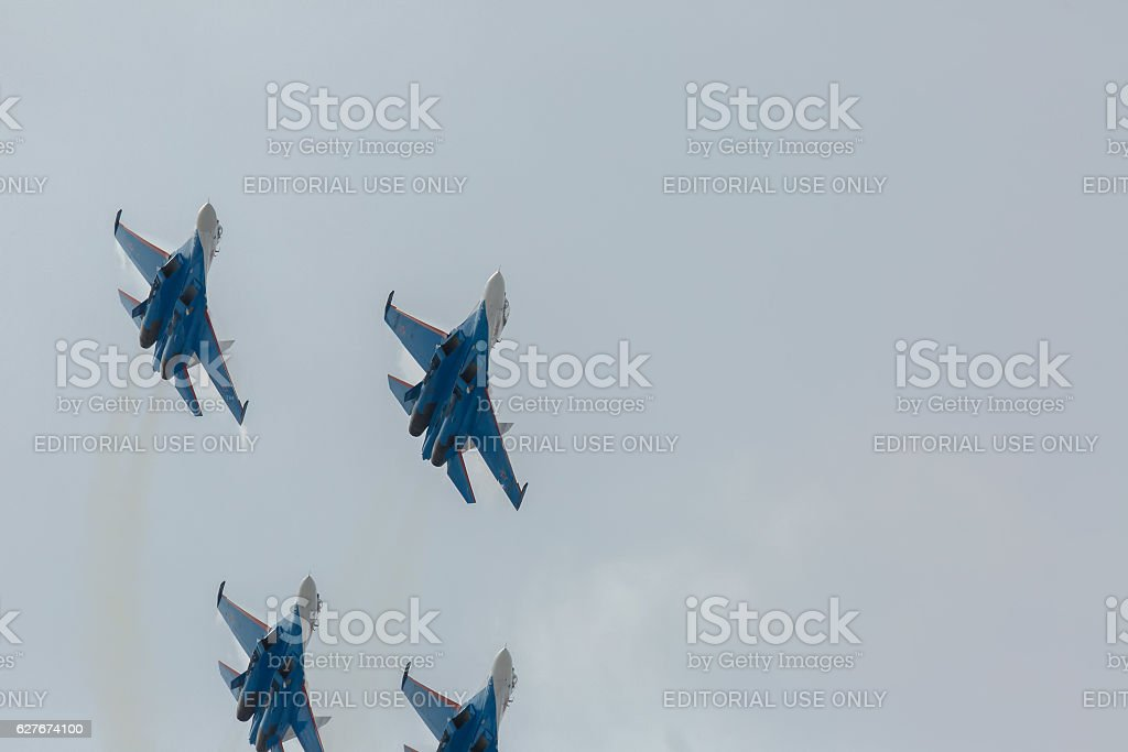 Fighter Sukhoi Su-27 show aerobatics at an airshow Russian stock photo