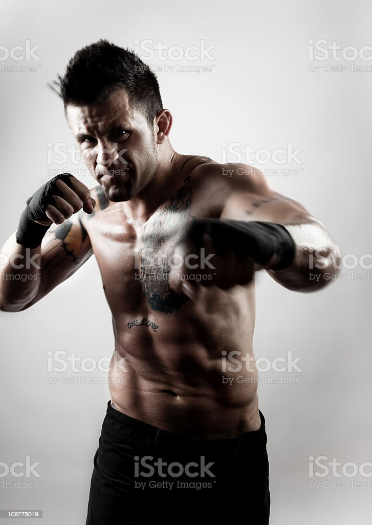 Fighter throwing a punch towards the camera royalty-free stock photo