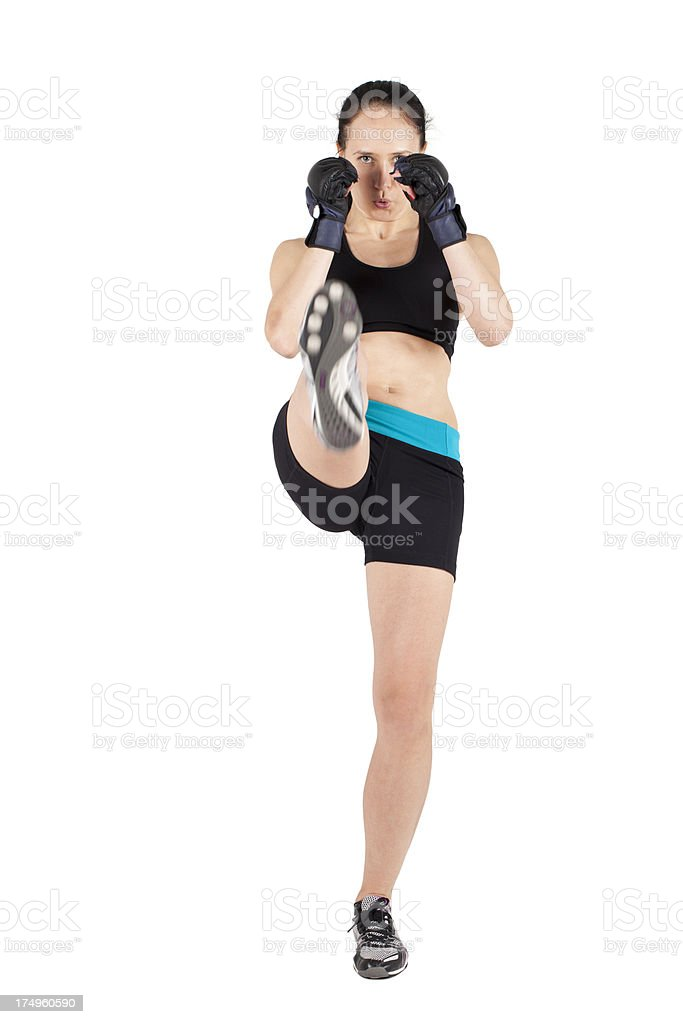 Fighter woman kicking isolated on white royalty-free stock photo