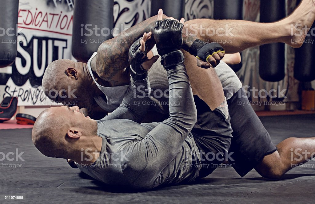 MMA fighters in action stock photo