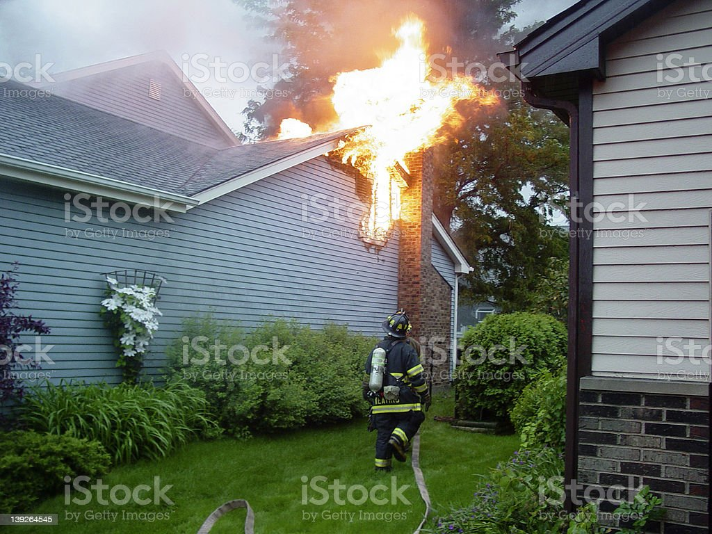 Fighting a House Fire stock photo
