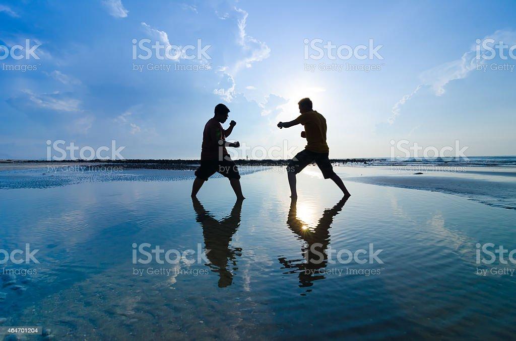 Fighting an enemy near the beach stock photo