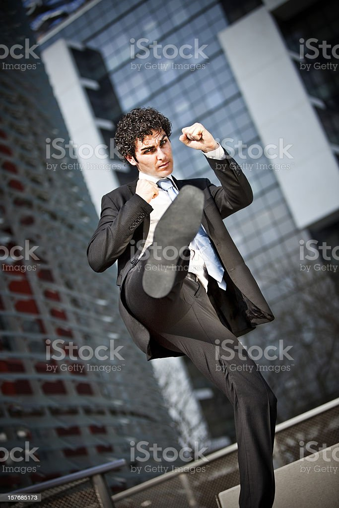 Fighting buisinessman royalty-free stock photo