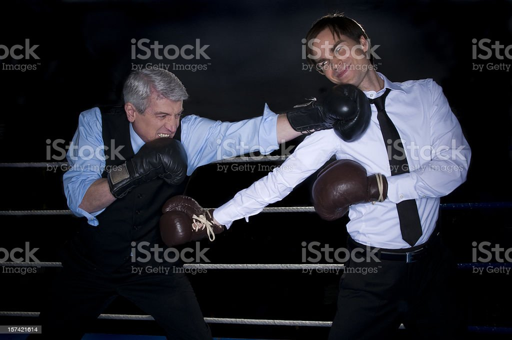fighting businessmen royalty-free stock photo