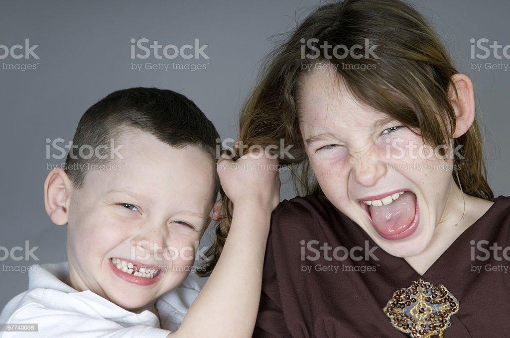 Fighting children stock photo