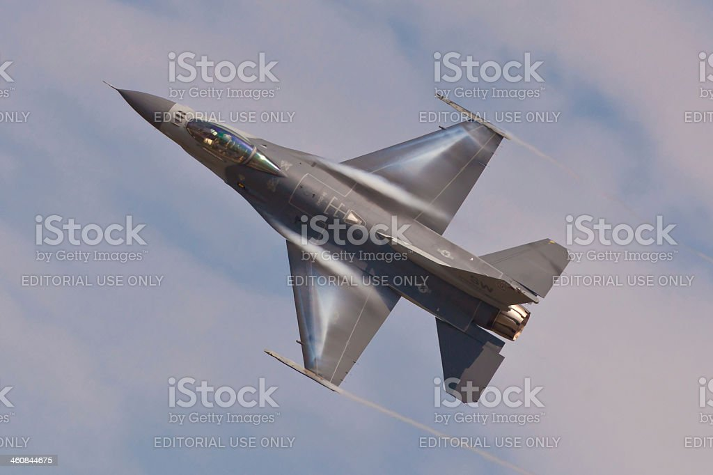 F-16 Fighting Falcon performing air show routine stock photo