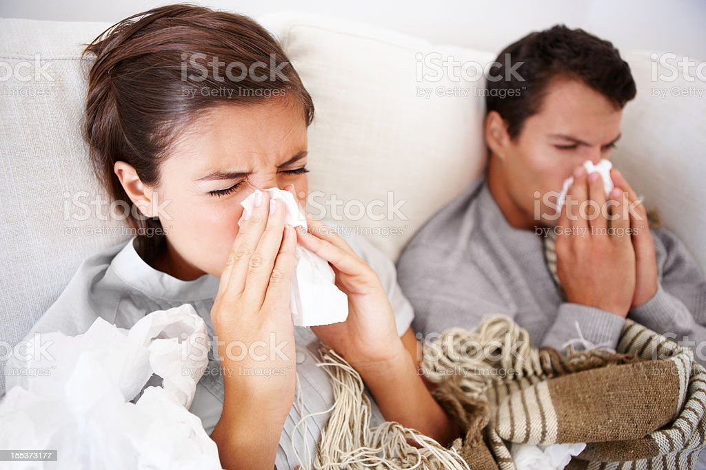 Fighting fever together stock photo