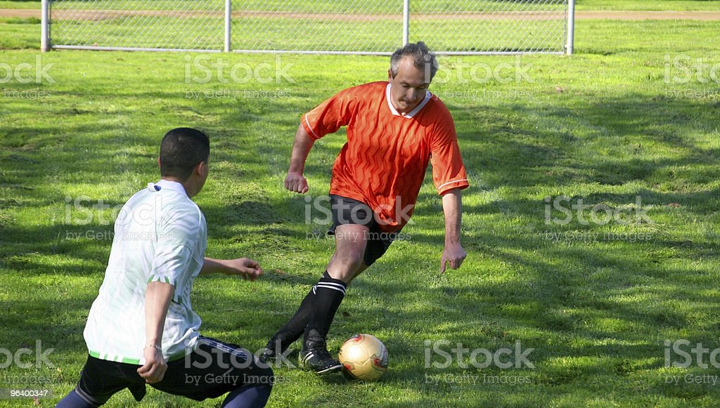 Fighting for a ball royalty-free stock photo
