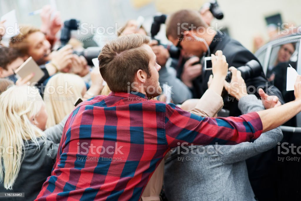 Fighting for a photo opportunity royalty-free stock photo