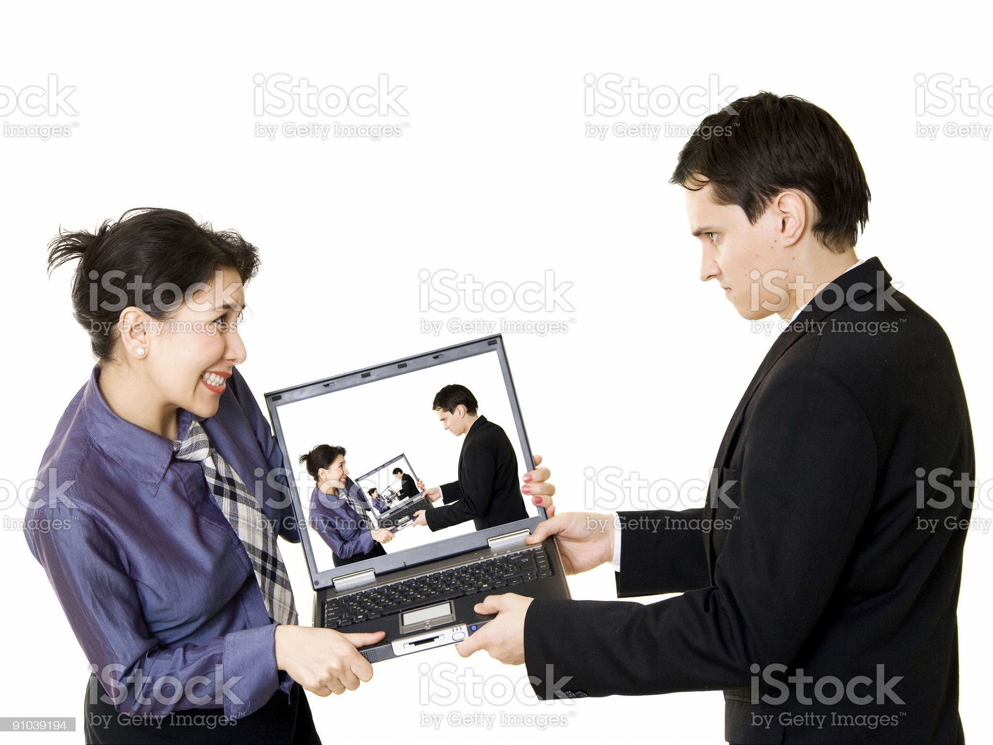 Fighting for laptop royalty-free stock photo