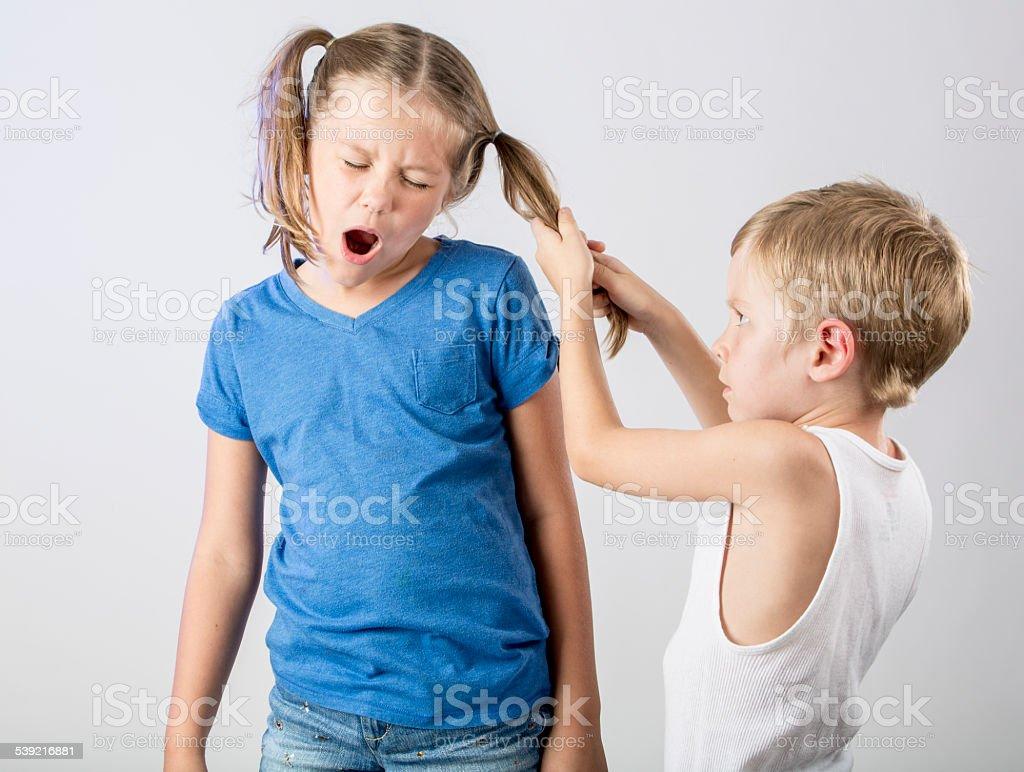 Fighting Kids stock photo