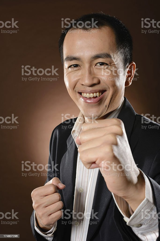 Fighting mature business man royalty-free stock photo