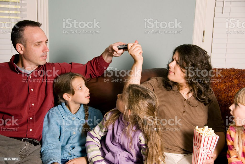 Fighting over the tv remote royalty-free stock photo
