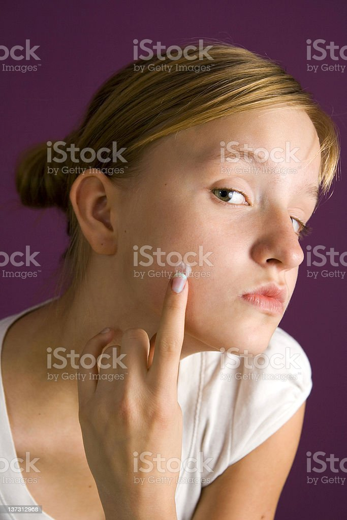 Fighting the pimple stock photo